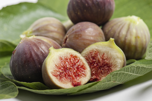 bunch of ripe figs on foliage